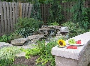 A natural looking waterfall completes the landscaping of this backyard