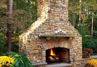 Custom Stone Fireplace completes a Backyard Design by GA Landscape Design