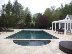 Clean lines and dark lining with a natural stone surround create a luxurious place to take a swim