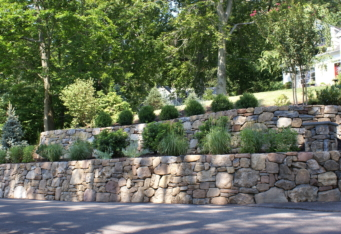 Stacked Stone Walls with plantings make for an inviting landscape design