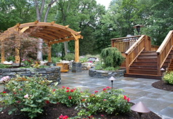 Blue Stone Patio with stone walls complete the landscaping of this Westfield NJ backyard