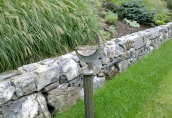 Moss Rock Stone Wall with new plantings create scenic landscaping