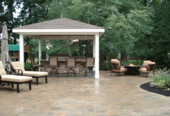 A Pavillion with an outdoor kitchen and a seating area with a fire pit complete the backyard living space in this Basking Ridge NJ backyard landscape