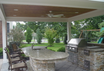 An outdoor kitchen complete the landscape construction done at this home in Basking Ridge NJ