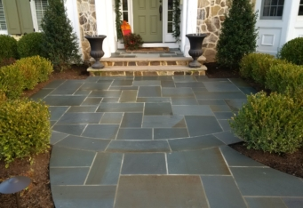 Bluestone Entry with plantings to line the way complete this front landscape design
