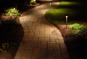 Landscape Lighting lights up a walkway at night
