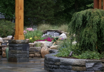 Custom Stone Walls and Waterfall create a relaxing landscape