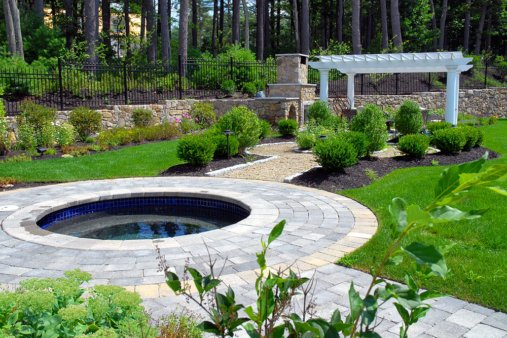 Custom Spa and Pergola in a high-end landscape design